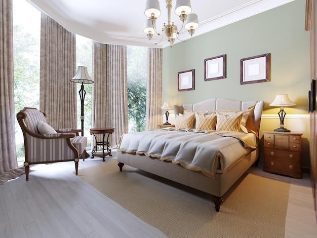 Schlafzimmer im englischen stil mit einem großen bett aus weichem stoff. nachttische mit lampen. großer kleiderschrank und kommode mit spiegel. 3d-rendering.
