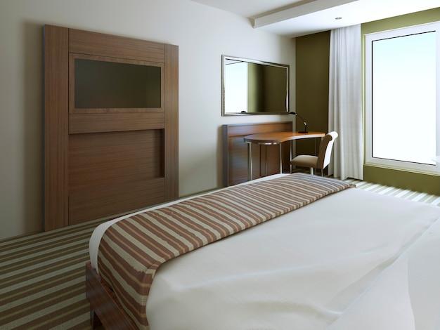 Schlafzimmer im minimalistischen stil in den farben weiß, braun und helloliv
