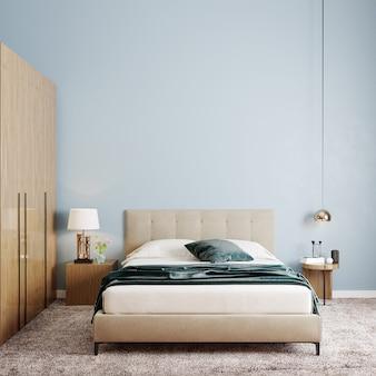 Schlafzimmer mit bett und kommode vor der blauen wand