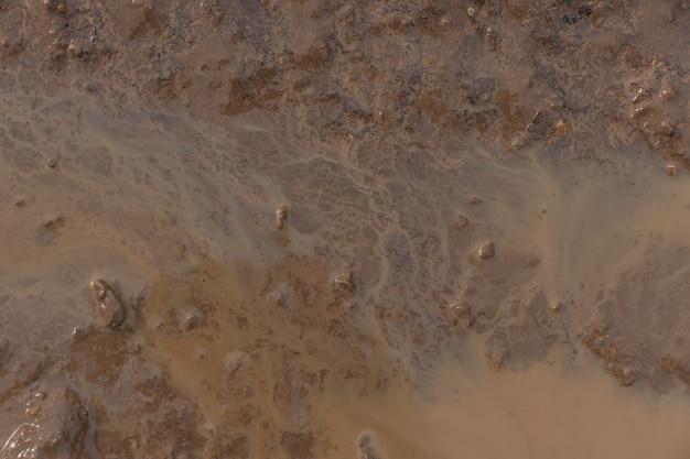 Schlammbeschaffenheit oder nasser grauer boden als natürlicher hintergrund.
