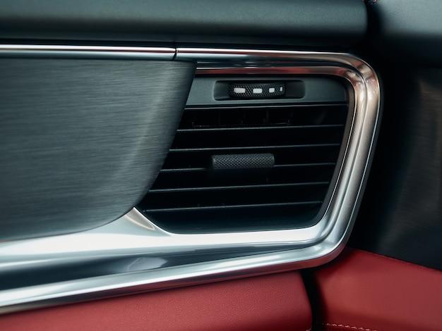 Schließen sie die details und bedienelemente des belüftungssystems des autos und der bedienelemente des modernen autos