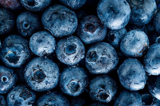 Schließen sie herauf bild der gruppe der blaubeer- und tautropfenfruchtmusterhintergrund