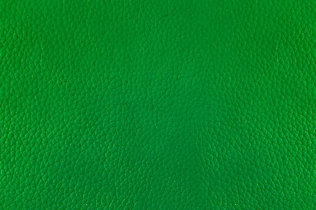Schließen sie herauf grünen leder- und beschaffenheitshintergrund