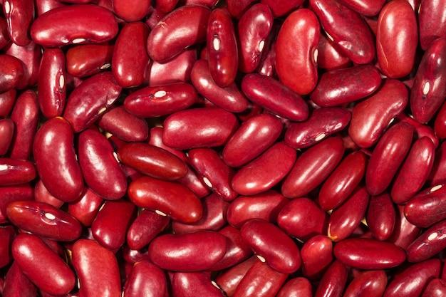 Schließen sie herauf roten gartenbohnebeschaffenheitshintergrund