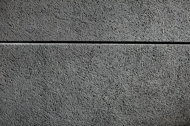 Schließen sie herauf textur einer wand mit einer grauen schallabsorbierenden platte, die darauf montiert wird