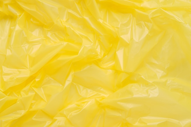 Schließen sie herauf textur eines gelben plastikmüllsacks