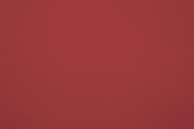 Schließen sie oben auf dem leeren roten papierbeschaffenheitshintergrund