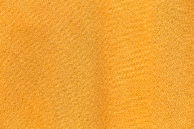 Schließen sie oben gelben stoff stoff hintergrund und textur.