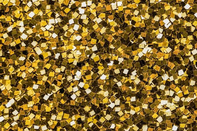 Schließen sie oben vom goldenen paillettenhintergrund