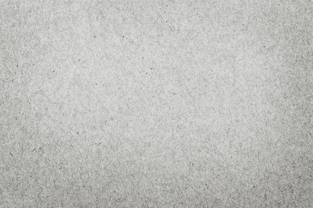 Schließen sie oben vom grauen strukturierten papierhintergrund