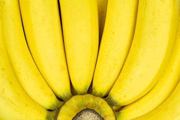Schließen sie oben vom neuen bananenhintergrund.
