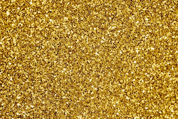 Schließen sie oben vom strukturierten hintergrund des goldenen funkelns