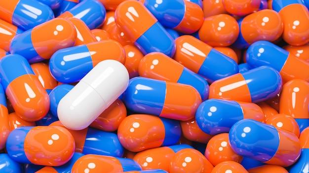 Schließen sie oben von der weißen pillenkapsel in vielen orange und blauen pillenkapseln