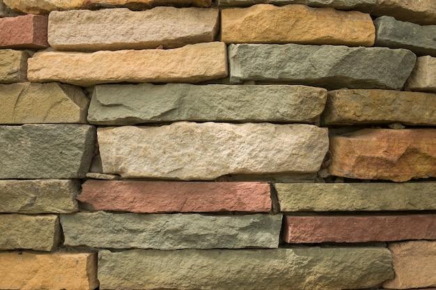 Schließen sie oben von einer backsteinmauer, moderner steinbeschaffenheitshintergrund