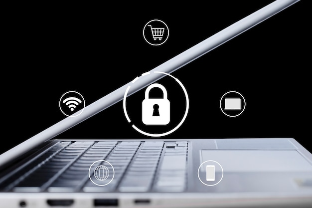 Schlosssymbol-sicherheitstechnologie mit einem computer-laptop auf schwarzem hintergrund