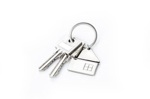 Schlüssel auf weißem? purchase-konzept platziert