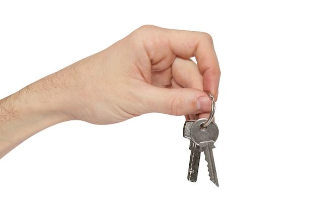 Schlüssel in der hand lokalisiert auf weiß