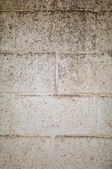 Schmutzige raue backsteinmauer