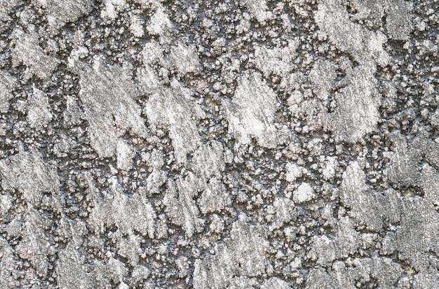 Schmutziger betonmaueroberflächenhintergrund der nahaufnahme
