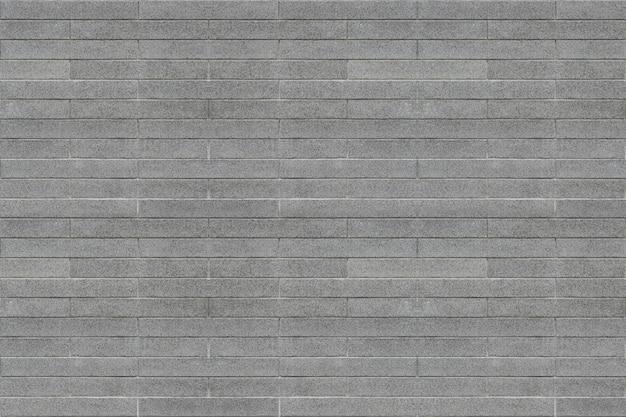 Schmutziger gealterter innenarchitekturhintergrund der grauen ziegelsteinweinleseart.