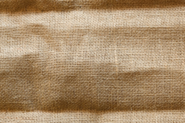 Schmutziger sackleinenbeschaffenheitshintergrund, braune baumwollstoffbeschaffenheit, leinwand