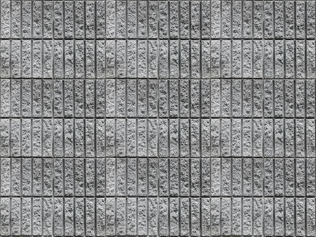 Schmutziger vertikaler zementziegelsteinblockstapelwand-beschaffenheitsoberflächenhintergrund.