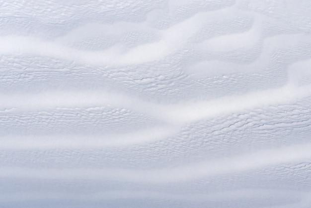 Schnee textur. weißer hintergrund mit abstraktion in der natur