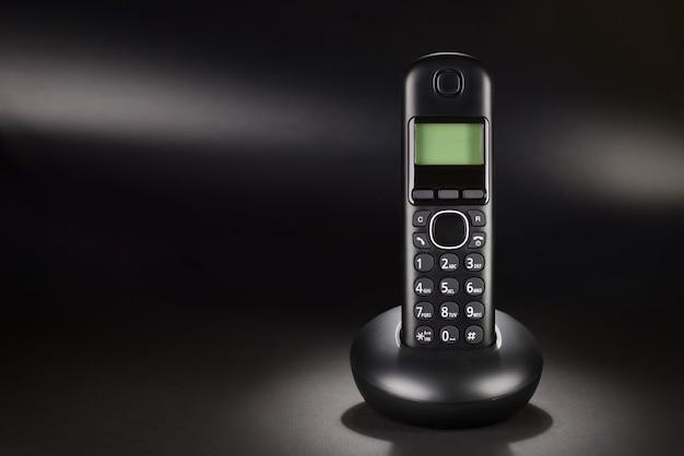 Schnurlostelefon auf schwarz
