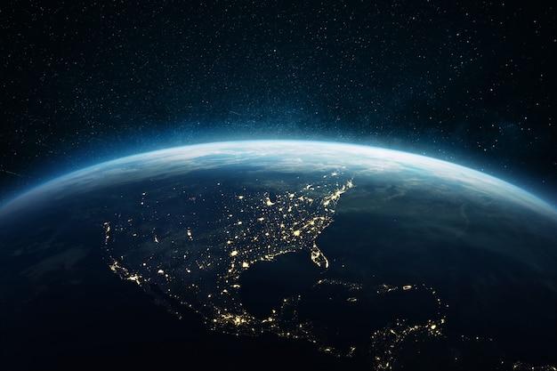 Schöne blaue planetenerde mit lichtern der nachtstädte usa, süd- und nordamerika. blick auf den nachtplaneten aus dem weltraum