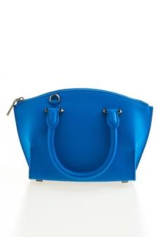 Schöne eleganz und luxusmodefrauen und blaue handtasche