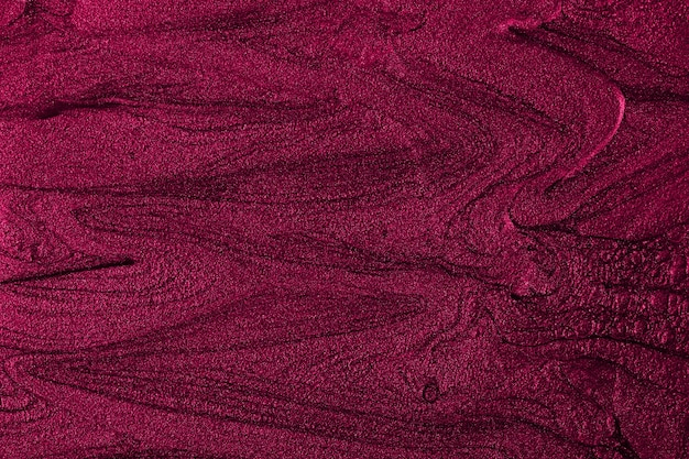 Schöne flecken von flüssigem nagellackfluid-art-technikheller lila marmorhintergrund