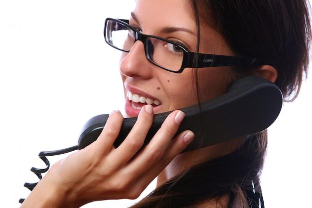 Schöne geschäftsfrau mit telefon