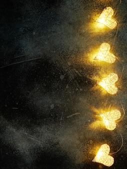 Schöne herzförmige lichterketten, die auf dunkelheit leuchten. hintergrund zum valentinstag