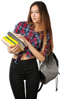 Schöne junge frau mit den büchern, getrennt auf weißem hintergrund. student