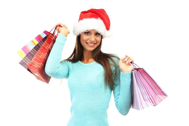 Schöne junge frau mit einkaufstüten, isoliert