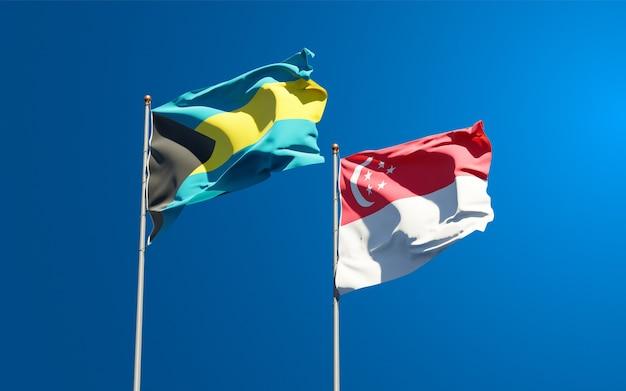 Schöne nationalflaggen von singapur und bahamas
