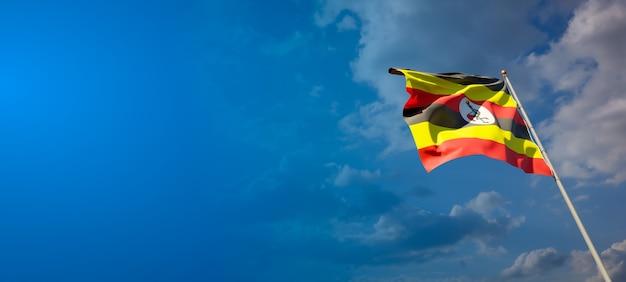 Schöne nationalstaatsflagge von uganda auf blauem himmel