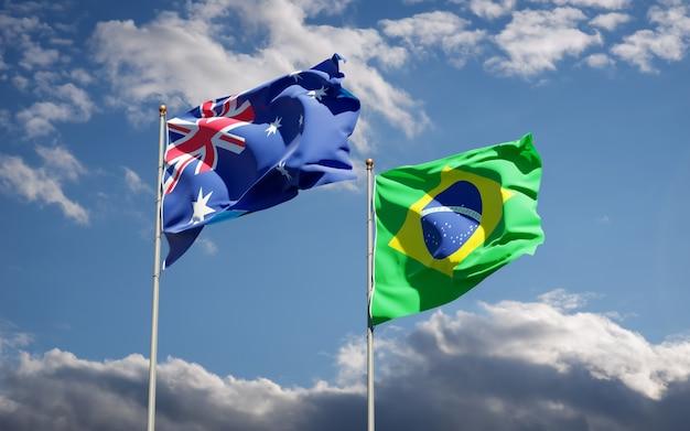 Schöne nationalstaatsflaggen von brasilien und von australien zusammen auf blauem himmel