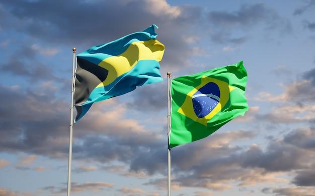 Schöne nationalstaatsflaggen von brasilien und von bahamas zusammen auf blauem himmel