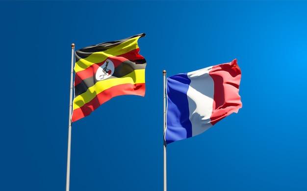 Schöne nationalstaatsflaggen von frankreich und uganda zusammen am himmel