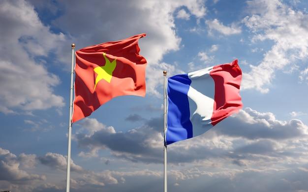 Schöne nationalstaatsflaggen von frankreich und vietnam zusammen am himmel