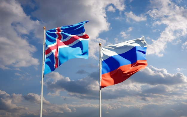 Schöne nationalstaatsflaggen von island und russland zusammen auf blauem himmel. 3d-grafik