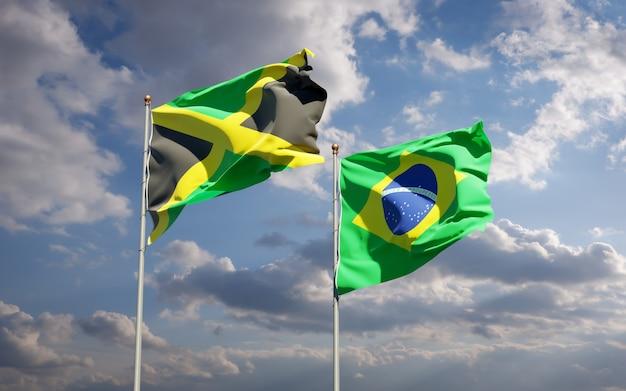 Schöne nationalstaatsflaggen von jamaika und brasilien zusammen auf blauem himmel