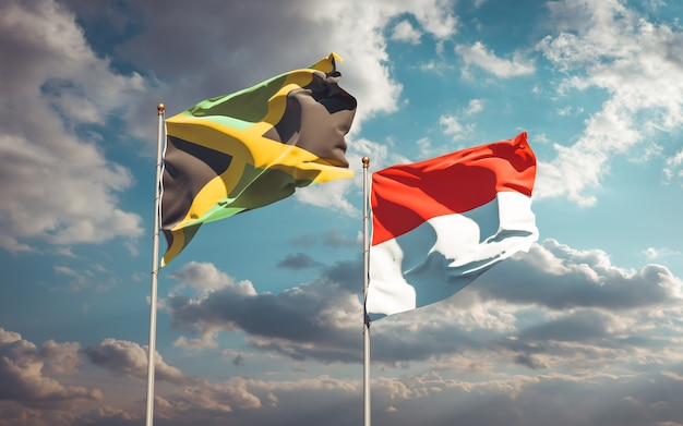 Schöne nationalstaatsflaggen von jamaika und indonesien zusammen auf blauem himmel