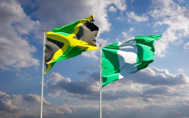 Schöne nationalstaatsflaggen von jamaika und von nigeria zusammen auf blauem himmel