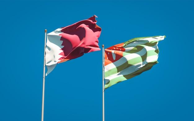 Schöne nationalstaatsflaggen von katar und abchasien zusammen