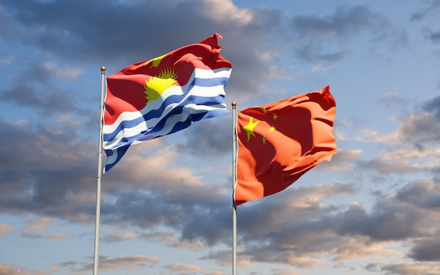 Schöne nationalstaatsflaggen von kiribati und china zusammen am himmel. 3d-grafikkonzept.