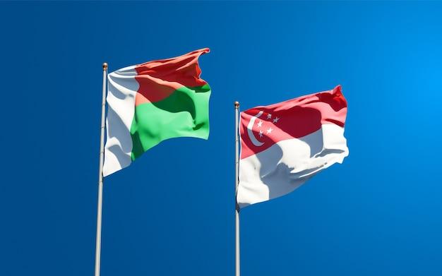 Schöne nationalstaatsflaggen von madagaskar und singapur zusammen