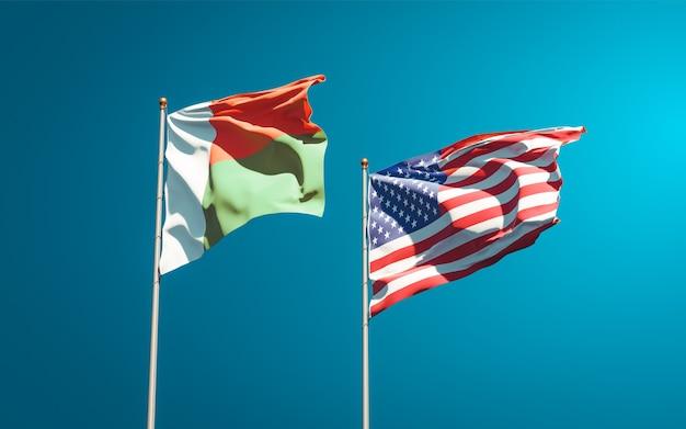 Schöne nationalstaatsflaggen von madagaskar und usa zusammen