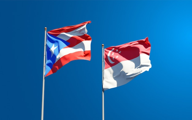 Schöne nationalstaatsflaggen von puerto rico und singapur zusammen